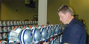 Troy Aikman signing Riddell pro line helmets